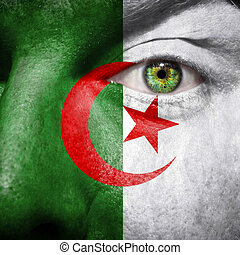 Algerian flag painted on a man's face to support his country...