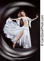 Beauty Girl belly dancer in white suit oriental dance in...