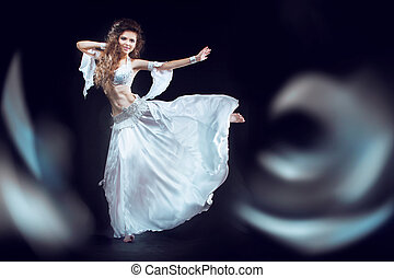 Beautiful exotic belly dancer woman running on the waves...