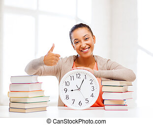 attractive woman with white clock - business, office, school...