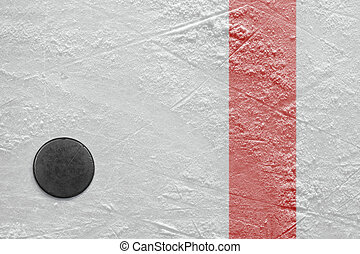 Puck on ice - Puck lying on a hockey rink. Texture,...