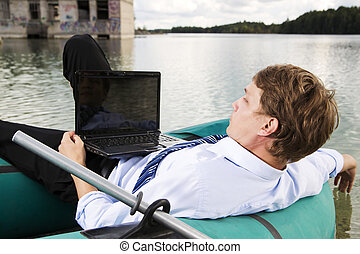 Man in costume lay over boat on lake