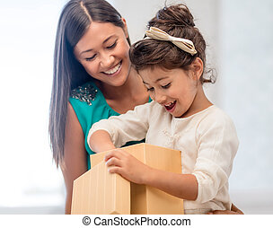 happy mother and child girl with gift box - holidays,...