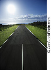 Airplane runway. - Airplane runway with Pacific ocean in...