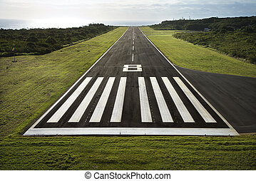 Airplane runway. - Aerial view of paved airplane runway on...