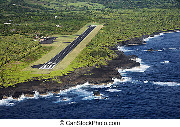 Airport runway. - Aerial view of landing airstrip on coast...