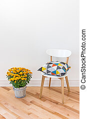Orange chrysanthemums bright cushion on a chair - Bright...