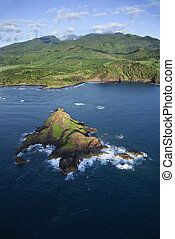 Maui landscape. - Aerial of rock jutting out of Pacific...