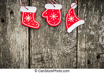 Red Christmas tree decorations on grunge wood background...
