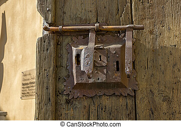 Ancient lock with latch. - Ancient iron lock with latch on...