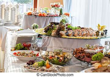 Snacks on banquet table - Different colorful snacks on a...