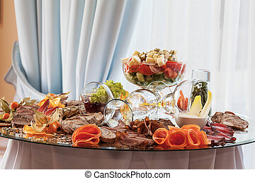 Appetizers at banquet table - Appetizing food snacks at...