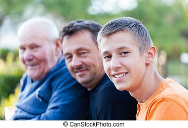 Male generations - grandfather, son and grandson.