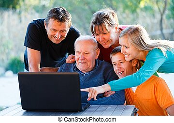 Showing something interesting - Teaching grandfather how to...