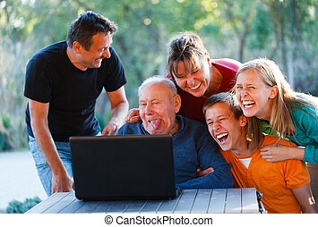 Funny grandpa - Family laughing together at the funny...