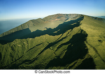Green Maui mountain. - Aerial view of green mountain with...
