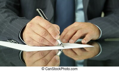 Fountain pen - Close-up of a businessman writing a document...