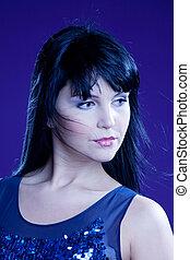 brunette girl in blue tones