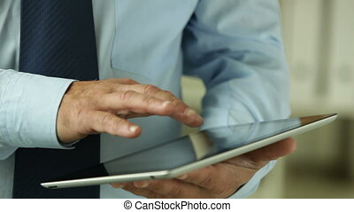 Tablet solution - White-collar worker using a tablet pc to...