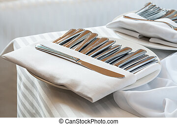 Silver cutlery on table