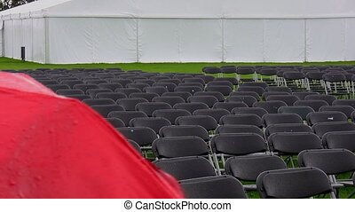 Raining Empty seats - Wet and empty rows of seats at a venue...