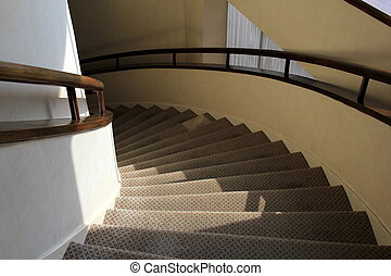 Curving staircase and handrails - Curving staircase with...