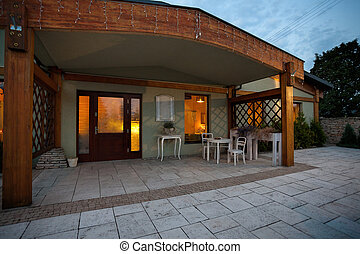 Entrance of a luxury restaurant with garden table