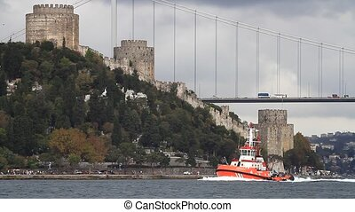 Pilotage service boat sailing past Rumelihisari fort in...