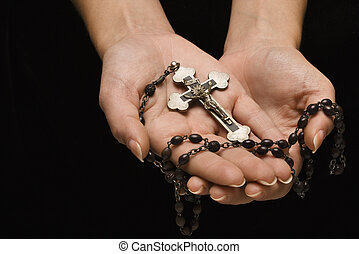 Religious icon. - Woman\'s hands palm up cradling rosary...