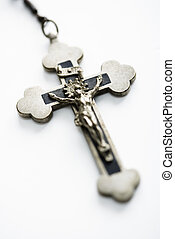 Christian crucifix. - Christian rosary crucifix on white...