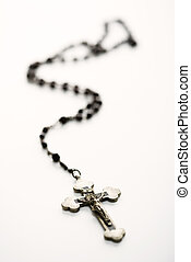 Religious still life - Christian rosary beads with crucifix...