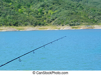Fishing rod over water - Castaic Lake in California