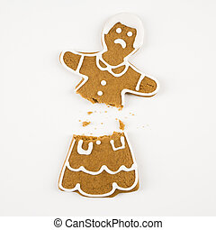 Broken gingerbread cookie. - Frowning female gingerbread...