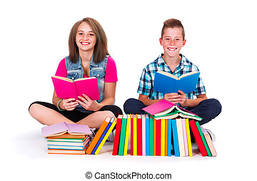 Students reading books - Teenage friends with many books in...