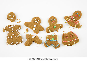 Broken gingerbread cookies. - Four frowning male and female...