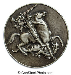 Metal medal depicting St George as a horse rider fighting a...
