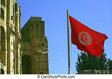 Flag of Tunis, el Jem - A fluttering flag above a wall...