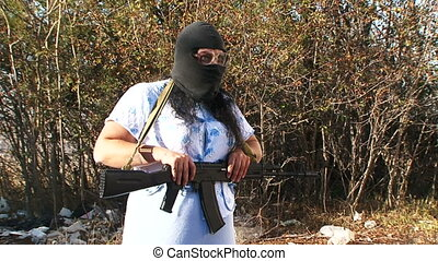 Equipped as a terrorist - Mad woman equipped as a terrorist