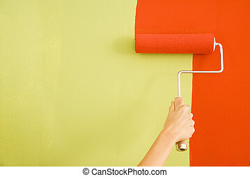 Woman painting wall. - Caucasian female hand painting red...