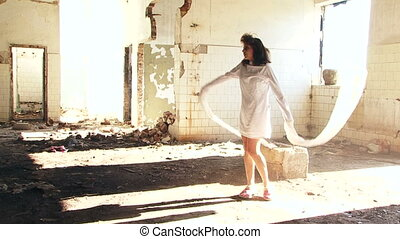 Madhouse - Mad woman in an abandoned hospital. Slow motion.