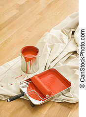 Painting supplies. - Painting supplies on drop cloth on wood...