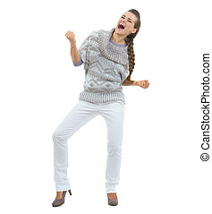 Full length portrait of happy young woman in sweater dancing