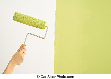 Woman painting wall. - Caucasian female hand holding paint...