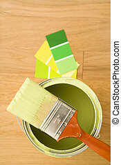 Paint with color swatches. - High angle view of paintbrush...