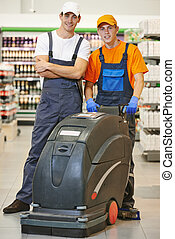 cleaning team with machine in store - Workers Floor care and...
