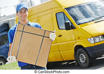 Delivery man with parcel box - Smiling young male postal...