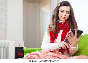 Pretty girl with e-book - Pretty girl with e-book on sofa at...