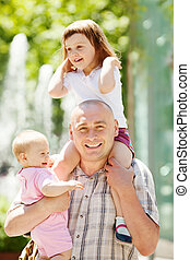 happy father with two daughters in sunny day - Outdoor...
