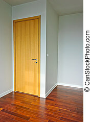 Empty room - Wooden door in empty room