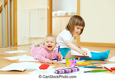 sibling plays with pencils - cheerful sibling plays with...